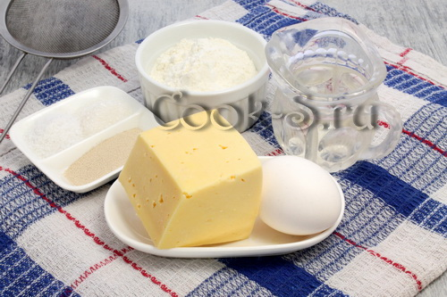 Закусочный торт из картофеля с сосисками, сыром и помидорами – кулинарный рецепт